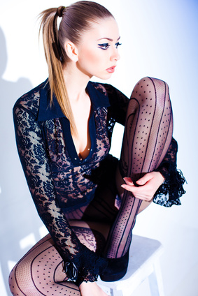 sexy model dressed in lace blouse and elegant tights