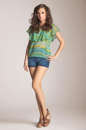 Brunette model presenting spring fashion