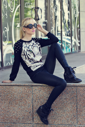 beautiful blonde girl in pullover with tiger print